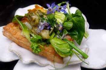 Spring vegetable and flower savory tart with goat cheese