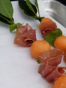 fresh melon, herb and prosciutto skewers on sheet