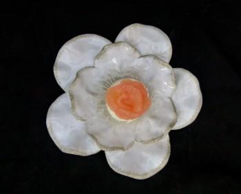 chèvre and grapefruit panna cotta  on rose petal dish