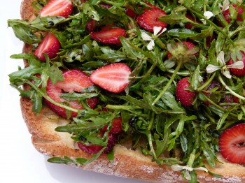 wild arugula and strawberry salad on a Ciabatta plank