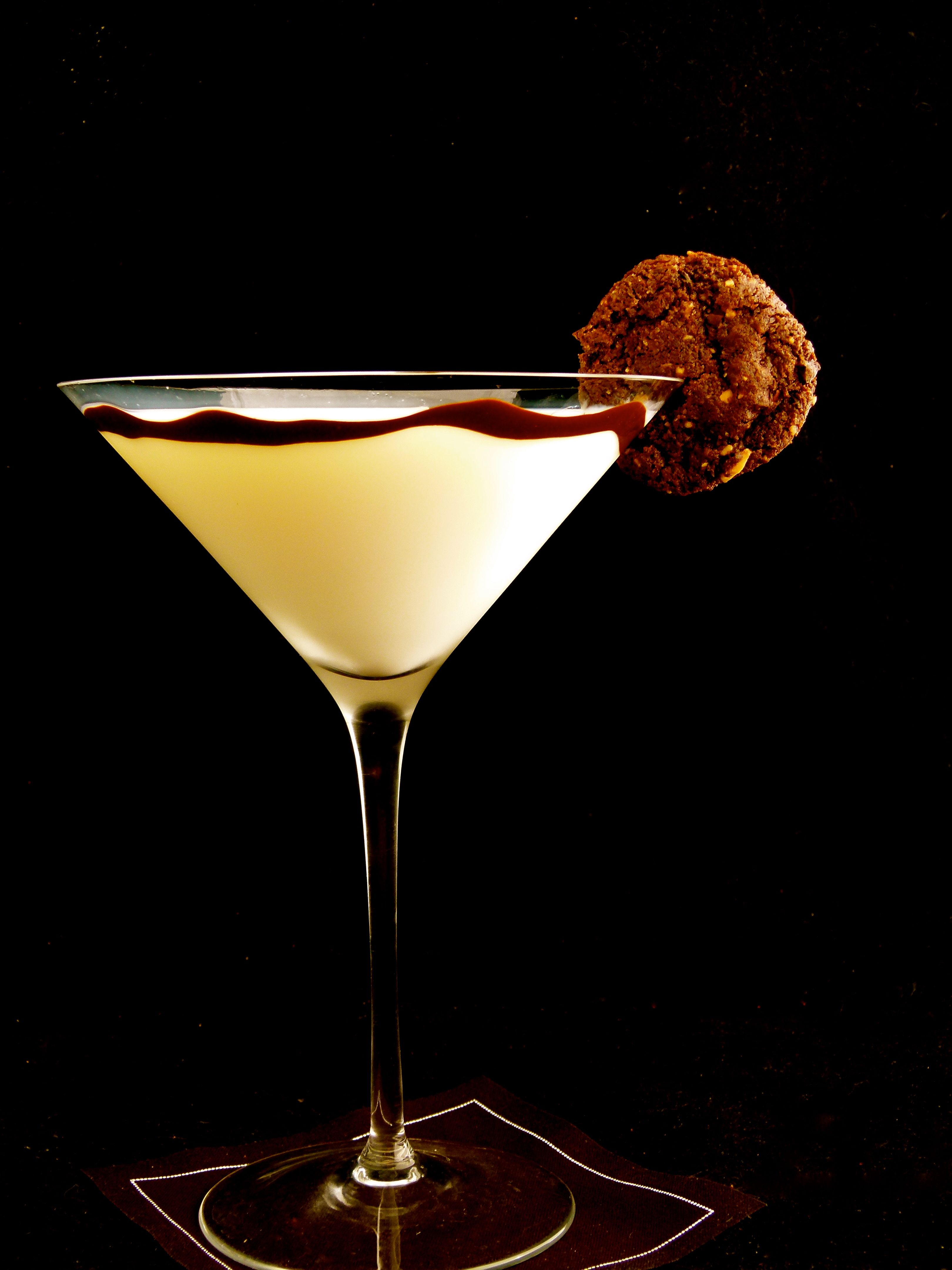 crunchy chocolate and espresso almond cookies in milk martini glass