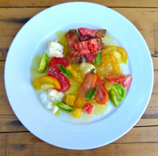 melange of garden heirloom tomatoes with burrata and whipped tomato purée