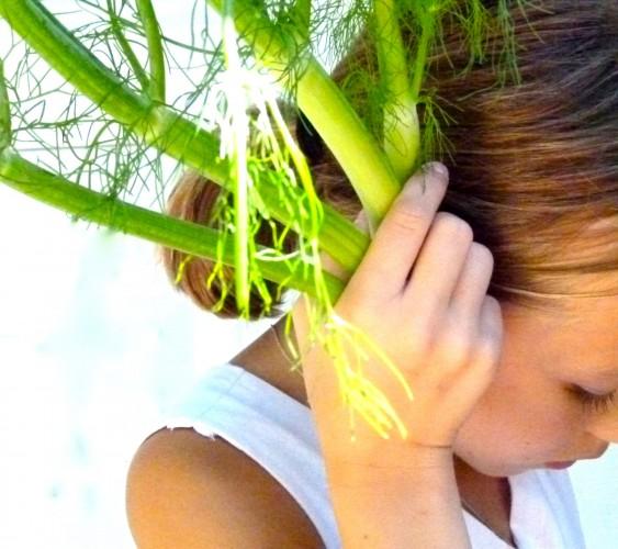fennel as headphones on a little girl