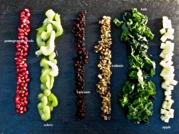 ingrediants for the updated Waldorf salad pomegranate seeds, celery, currants, walnuts, Kale
