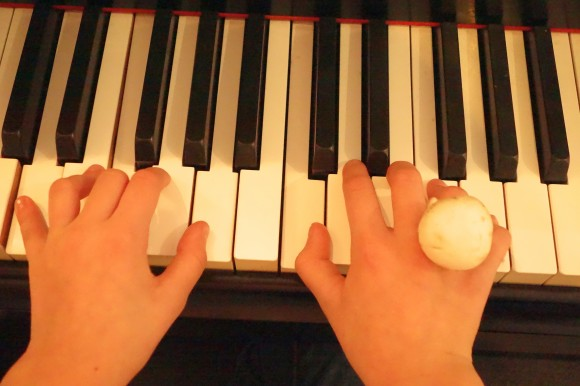 girls hands at piano with mushroom ring