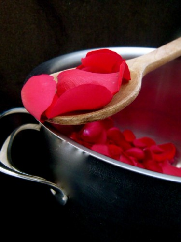 valentines day rose petals spooned out of a pot