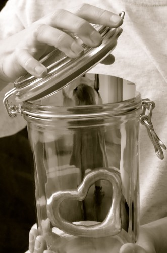 girl preserving doll in glass jar