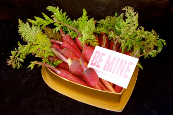 valentines day red carrots, with a Be mine sign