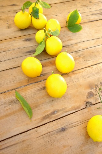 fresh lemons on a wood table
