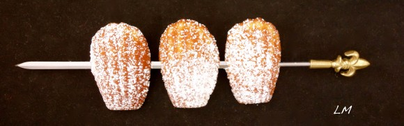 cupids bow with three powdered sugar dusted madeleines