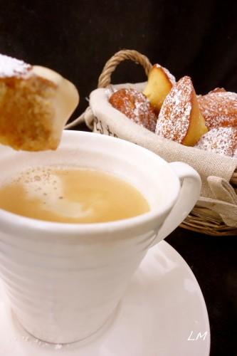 Madeleines dunking into tea