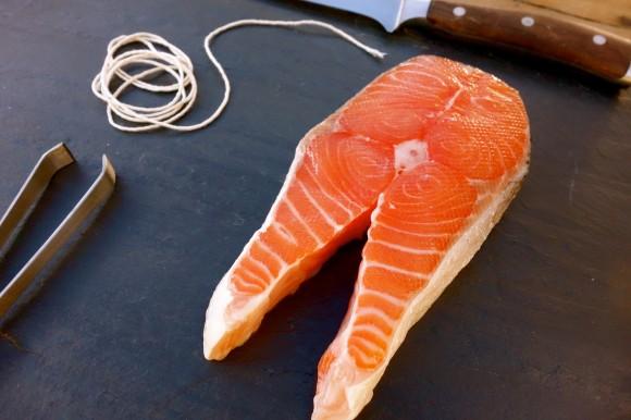 salmon on cutting board with knife